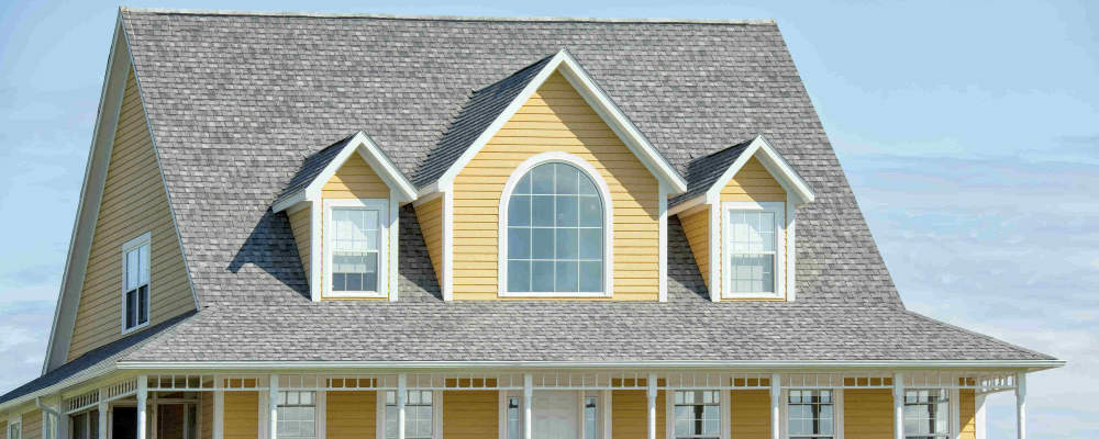 Roofing installation with dark and light gray roof shingles